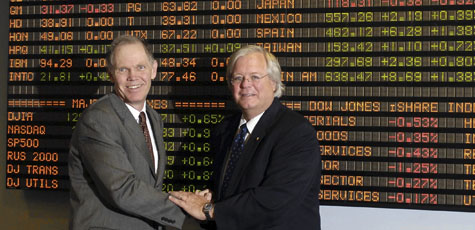 Dean Clark with a member of the Board of Visitors in the Financial Markets Room