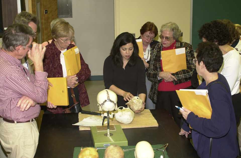 Dr. Midori Albert at UNCW College Day, talking about osteological analysis with members of the public