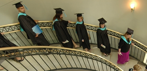 Graduates wait on the spiral staircase in the Education Building.