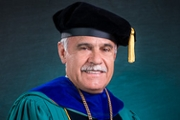 Chancellor Sartarelli in cap and gown