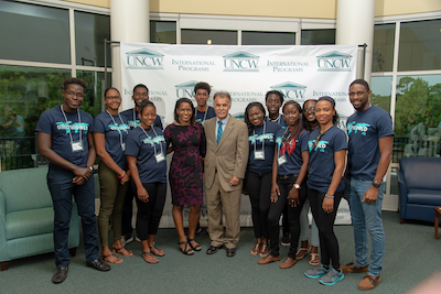 Chancellor Sartarelli with students and an instructor from the University of the West Indes in Barbados.