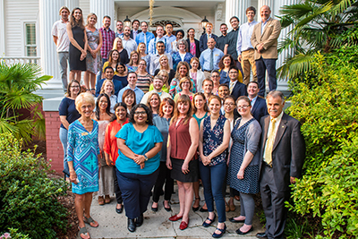 Provost Marilyn Sheerer, front row, far left) and Chancellor Sartarelli (front row, far right) pose with new faculty on the steps of the Wise Alumni House.