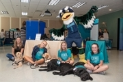 Sammy C. Hawk with CHHS seated students and service dog trainees.