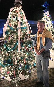 Chancellor standng next to decorated tree