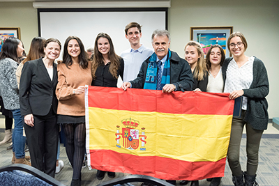 Chancellor Sartarelli and international students display flag of Spain