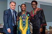 Chancellor Sartarelli (left), UNCW Senior Sankofa medal recipient and Stephania Bloodworth '00, president of the African American Graduate Assocation