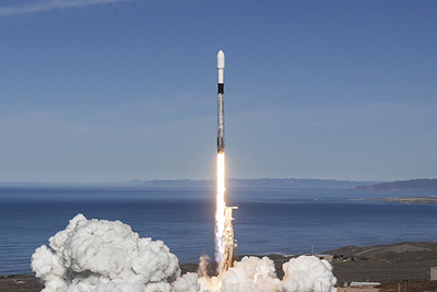 SpaceX rocket taking off from launch pad
