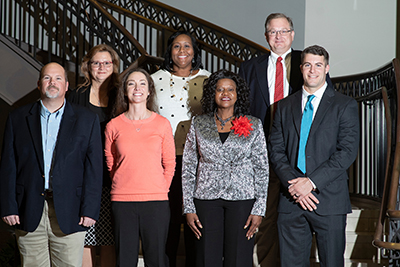 WCE doctoral candidates in front of staircase in the Watson College of Education