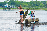 Students in the Island Ecology class look for marine specimins off Carolina Beach State Park