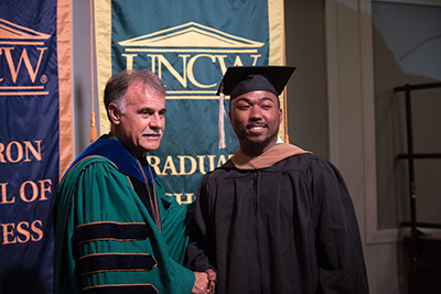 Chancellor with M.S.A. candidate