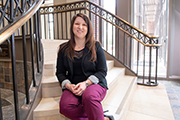 Nicole Geczi on the steps inside the Education Building
