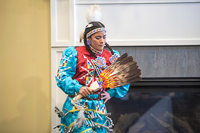 Shauni Bird, in colorful Native American dress, performs a dance