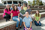 Associate Dean of Undergraduate Studies and Honors College Director Shawn Bingham (center), surrounded by Honors College students in front of the Fisher Student Center.