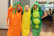 Students dressed as carrot, squash and peas pose at the Student Health Fair, held in conjunction with CHHS Week.
