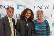 Left to right: Chancellor Sartarelli, unidentified student, Vice Chancellor for Student Affairs Pat Leonard