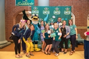 Sammy C. Hawk surrounded by Advancement team.