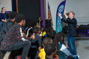 Brian Hamilton gestures to a group of D.C. Virgo students.
