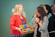 Stacey Kolomer (right) gets excited as Diane Durance hands her the Kickbox Gold Box.