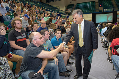 Chancellor shakes hands with Seahawk parent