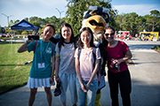 Sammy C. Hawk (behind) and four international students at the Food Truck Rodeo.