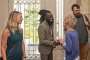 Provost Marilyn Sheerer (second from right) greeting three new faculty members at a reception at the Wise Alumni House.
