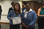Two international students at reception in their honor.