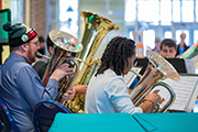 Closeup of three tubas and their players