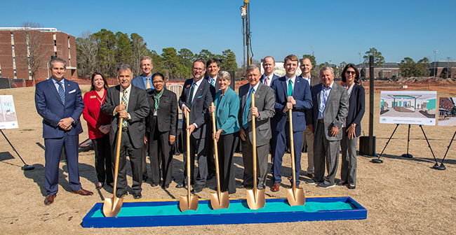 Group photo at groundbreaking for student housing.