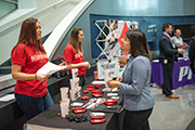 Students talk with potential employers at CSB career fair