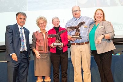Left to right: Chancellor Sartarelli, Provost Sheerer, Ann Pabst (holding Seahawk statuette), Bill McLellan (holding Seahawk statuette) and Panda Powell.