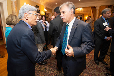 Chancellor Sartarelli (left) shakes hands with Yousry Sayed, friend of UNCW and major donor