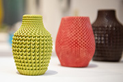 Three vases on display in Gene Felice's solo exhibition.