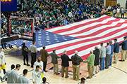The American flag is unfurled for the singing of the National Anthem before the Military Appreciation game.