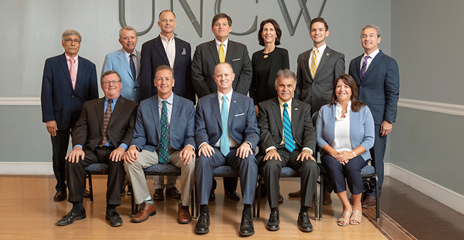 Board of Trustees portrait. Front Row (L to R) Michael Drummond, Dennis Burgard, Henry Kitchin, Jr., Chancellors Jose Sartarelli, Gidget Kidd. Back Row (L to R) Yousry Sayed, Robert Rippy, Woody White, Hank Miller, Agnes Beane, Nicholas Pianovich, Michael Lee.