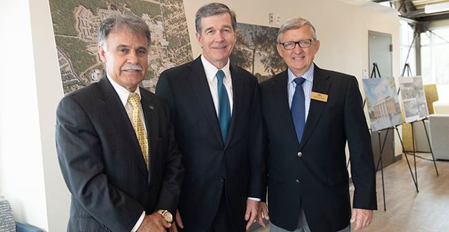 Chancellor Sartarelli (left), Governor Roy Cooper (center) and UNCW Board of Trustees Chair Ronnie McNeill (right).