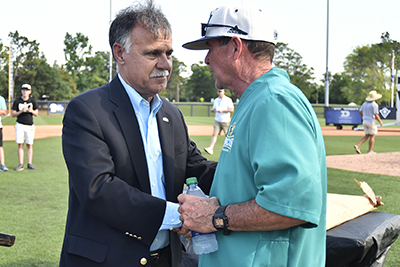 Chancellor (left) shakes hands with Mark Scalf (right).