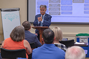 Chancellor Sartarelli speaks to a group of New Hanover County employees.