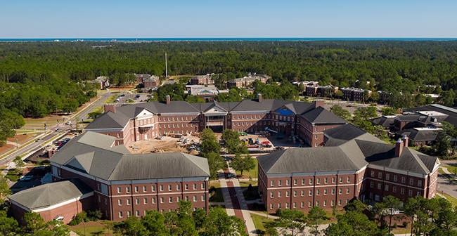 Veterans Hall quad from the air, with ocean visible on the horizon.