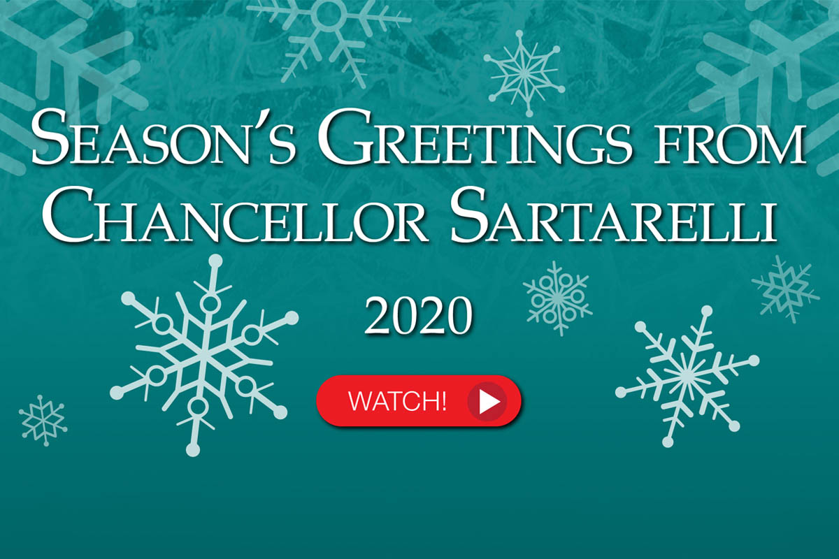 Teal background with white snowflakes. Text: Season's Greetings from Chancellor Sartarelli