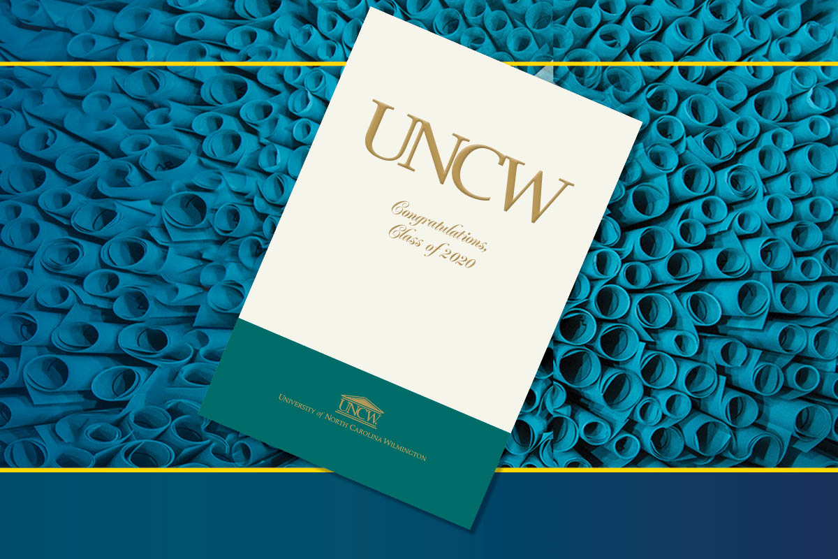 Commencement program cover on top of an image featuring teal rolls of paper representing diplomas.