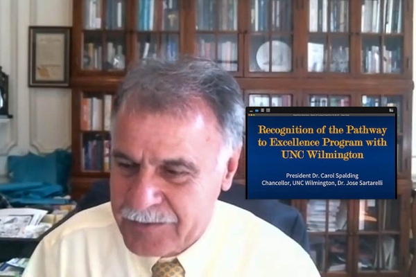 Chancellor Sartarelli, via Zoom, with a screenshot next to him recognizing the Pathways to Excellence program.