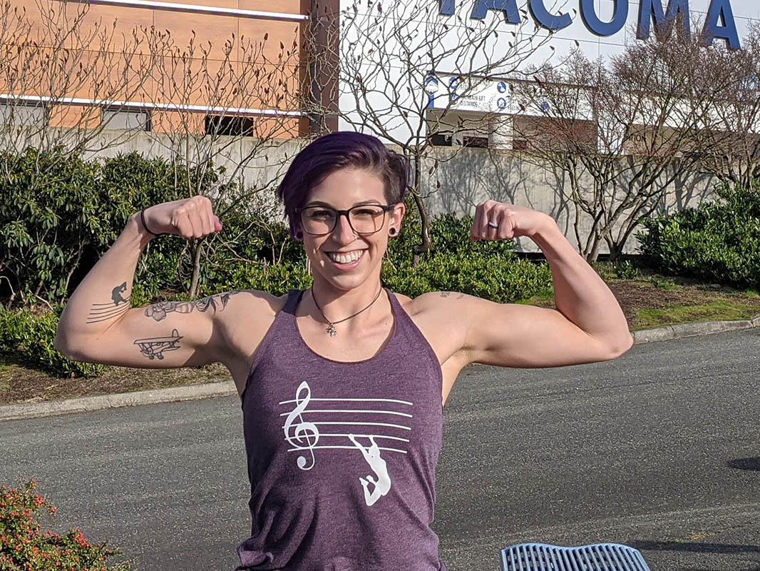 """Megan Budway flexes her muscles outside the Tacoma Dome before her apperance on """"American Ninja Warrior."""""""