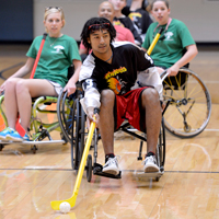 Recreation students play hockey in wheelchairs