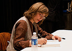 Azar Nafisi autographs her latest book after giving the Buckner lecture in the Lumina Theater. -- Photo by Kathy Rugoff