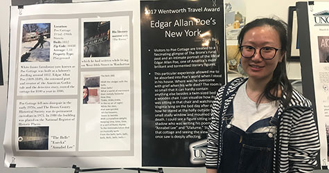 (Photo above) Zijun Bu stands next to her poster at the 2018 Wentworth Fellows Spring presentation in Randall Library. She showcased her journey to New York City where she visited  the sites important to horror writer and poet Edgar Allen Poe. - Photo by Hanna Wickes