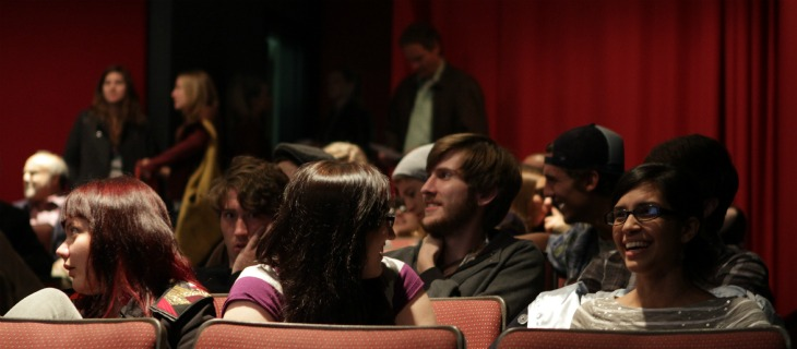 students sitting in theater