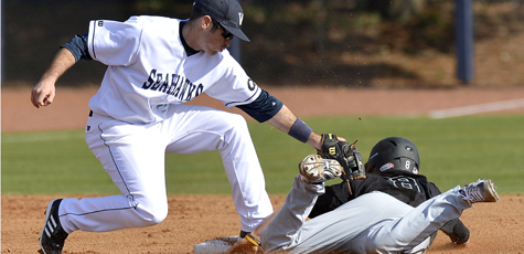 Seahawk baseball player taqs-out a competitor while sliding into 2nd base