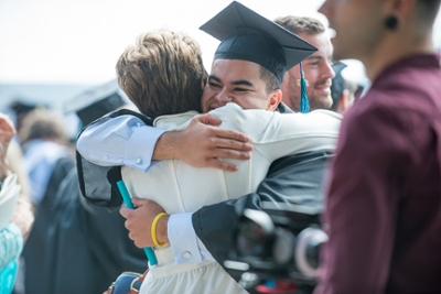 graduate hugs his mom.