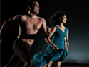 A man and a woman engaged in modern dance