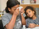 "K-12 students in UNCW's MarineQuest summer programs peer through origami-like microscopes called ""Foldscopes."""
